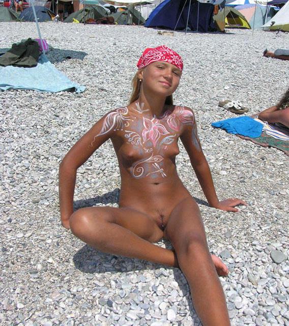 Family nude beach body paint