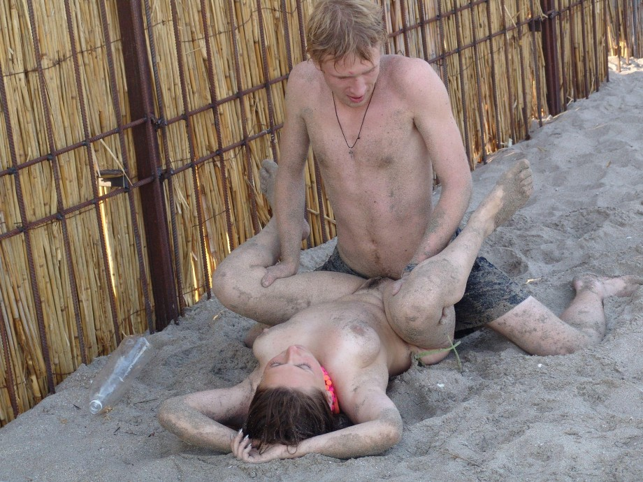 Couple having sex on nude beach