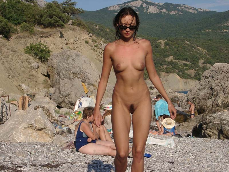 Cute brunette nude at public beach TOP