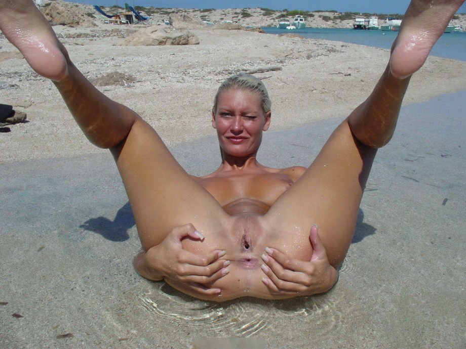 Horny blonde at the beach TOP