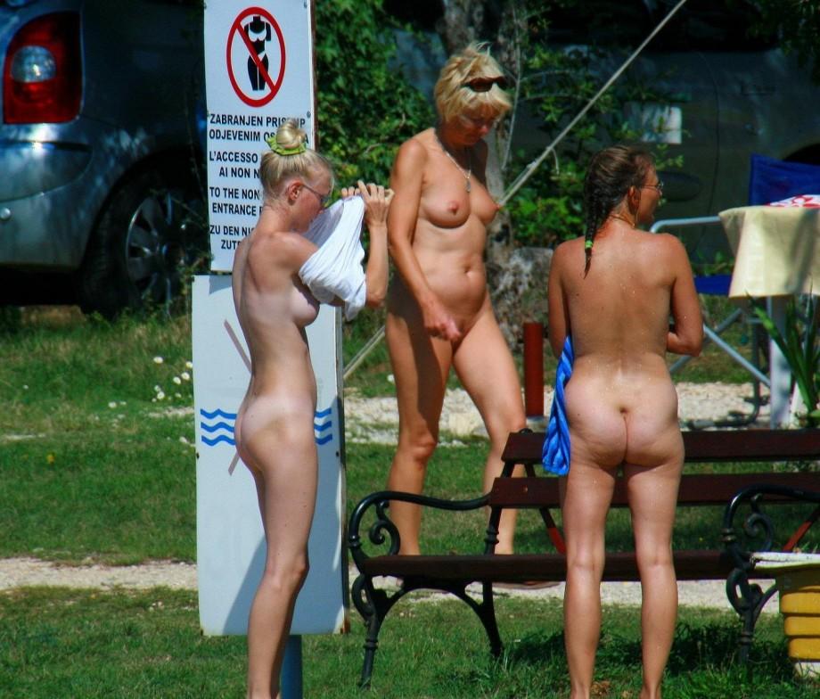 beach legs wide open at nudist beach