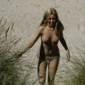 Swedish blond teen having fun on the beach