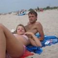 Young russian couple showing holiday pics
