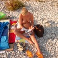 Blond girl at nudist beach