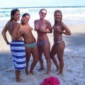 Amateurs girl topless group shot on the beach