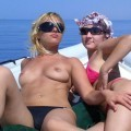 Two amateurs girl topless shot on the beach