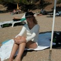 Sandra and her photos from holiday on nudebeach