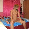 Young blonde girlfriend possing on bed
