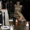 Amateur barmaid - naked in work