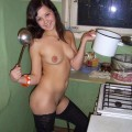 Naked amateur girls cook in the kitchen