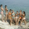 7 girls topless group shot on the beach