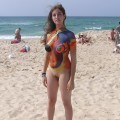 Amateur nudists and theirs beach body painting