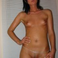 Nice brunette girl likes nude posing
