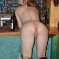 Girl with botle in pussy on the bar