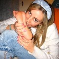 Young teens kiss her feet
