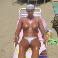 Amateur couple and their beach holiday pics