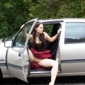Brunette uses her toy at the car