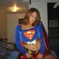Dresses up in a supergirl outfit and masturbation