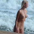 Totally nude at the beach