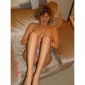 Woman with nice legs showing herself naked