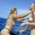 Two shaved girls on a boat