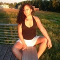 Latina posing outdoors