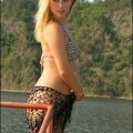 Hot young blonde naked at a lake