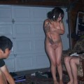 Tattooed girls get naked at a party