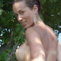 Busty melissa stripping in nature