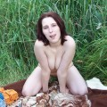 Chunky brunette posing in/outdoors