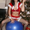 Christmas girl sexy posing for boy