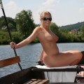 Cute blond girl naked on vacation