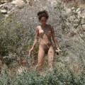 Naturist hippie young girl on a beach in spain