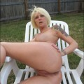 Blonde tatooed wife naked at garden