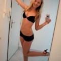 Blonde beauty strip selfshot