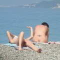 Two teen girls naked on the beach togethe
