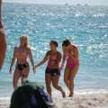 Three teen girls blend in on a nudist beach