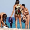 Three hot teens on the nudist beach 2