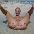 Horny blonde at the beach