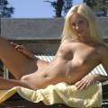 Pikotop - blonde sunbathing by the pool