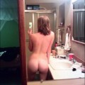 Selfshots - blonde girl in front of mirror