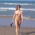 Naked girlfriend on the beach