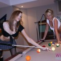 Girls play pool