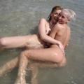 Licking lesbians on beach - 4