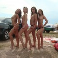 A bunch of girls topless on the beach
