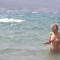 Topless beach vacation photos of hot blonde woman