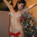 Girl poses naked on christmas