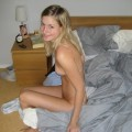 Pretty shaved blonde posing on her bed