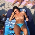 Topless girlfriend on the beach