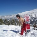 Topless on snowboard